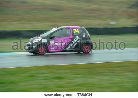 Dunfermline, Scotland, UK. 7th April, 2019.   74 Emily Lanvill into the Chicane during a Scottish Citroen C1 Cup  race at Knockhill Circuit. During a wet and misty opening round of the Scottish Championship Car Racing season organised by the SMRC (Scottish Motor Racing Club) at Knockhill. Credit: Roger Gaisford/Alamy Live News - Stock Image