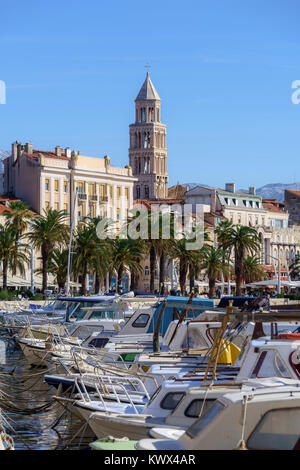 Fishing boats near Riva domniated by Cathedral Bell Tower, Croatia - Stock Image
