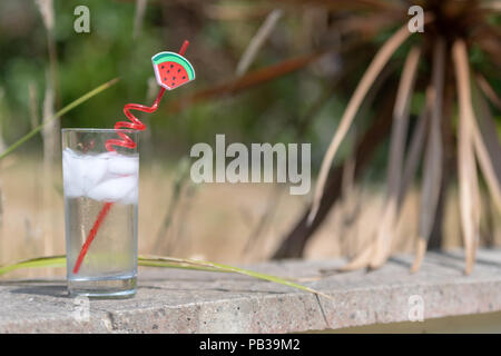 Poole, UK. 26th July 2018. Hot temperature as the UK heatwave continues. Shown with a glass of iced water with a straw. Credit: Thomas Faull/Alamy Live News - Stock Image