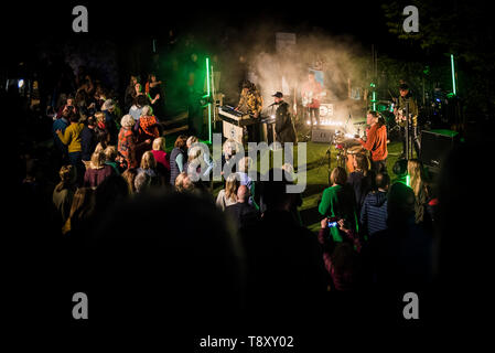 Audience dancing as Smoove and Turrell, a Northern Funk band perform at Trebah Garden Amphitheatre in Cornwall. - Stock Image
