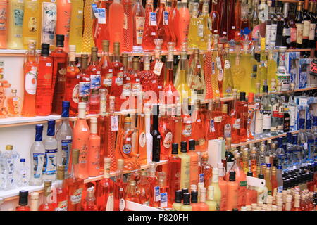 Market stall selling limoncello, orange limoncello and kumquat liqueur in Old Corfu Town, Corfu, GREECE, PETER GRANT - Stock Image
