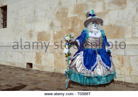 A participant at the Annecy Venetian Carnival. Annecy. Auvergne-Rhone-Alpes, south east France. - Stock Image