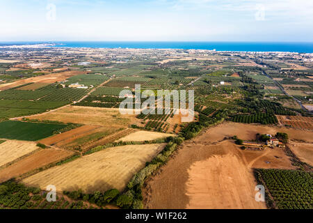 top view of crop farm fields near of Salou at the Mediterranean sea in Tarragona, background field agricultural industry aerial view - Stock Image