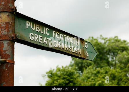 20th century style public footpath sign at Little Grandsden, Cambridgeshire pointing to Great Grandsden. - Stock Image