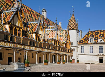 Courtyard of 'Hotel Dieu' with glazed tile dormer windows weather vanes and small spires of worked lead in Beaune Burgundy France  'HOTEL DIEU' BEAUNE - Stock Image
