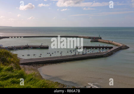 The harbour of Port-en-Bessin-Huppain in Normandy, France, on the English Channel, at sunset. Aerial view, between low and high tide. - Stock Image