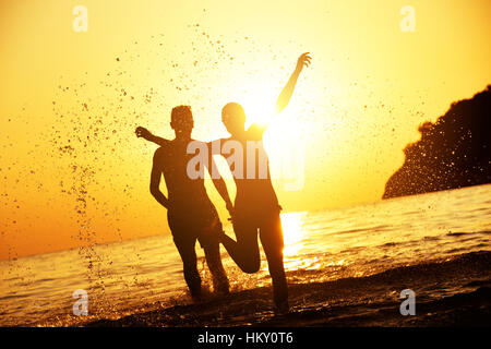 Travel concept susnet beach love - Stock Image