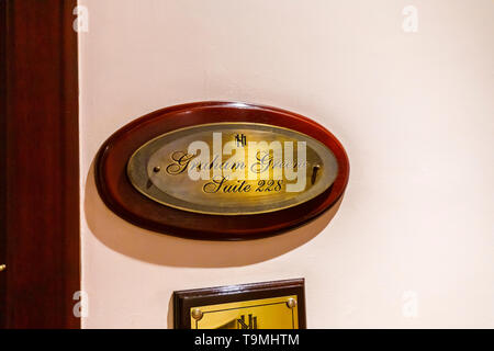 Brass plaque outside the Graham Green Suite, room 228 in the Sofitel Legend Metropole Hanoi hotel, Hanoi, north Vietnam, south-east Asia - Stock Image