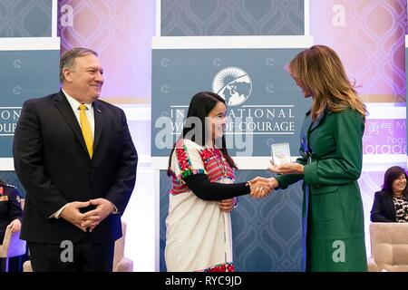 U.S First Lady Melania Trump, right, and Secretary of State Mike Pompeo, left, present Naw K'nyaw Paw of Burma with the 2019 International Women of Courage awards at the State Department March 7, 2019 in Washington, DC. - Stock Image