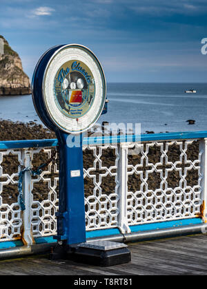 Traditional Weighing Machine on Llandudno Pier, a Grade II* listed pier in the seaside resort of Llandudno, North Wales UK, opened 1877. - Stock Image