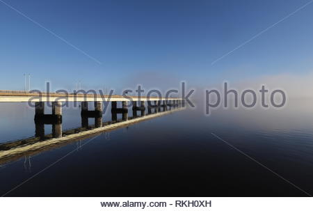 Tay Road Bridge reflected in River Tay with fog Dundee Scotland  January 2019 - Stock Image