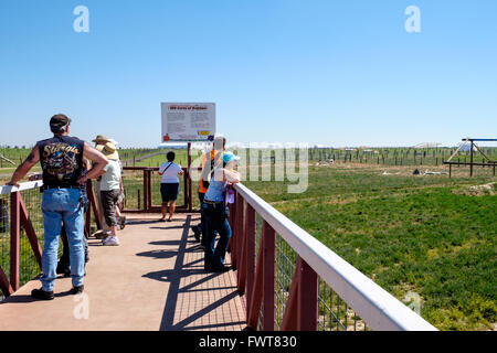 Visitors gaze over various animal enclosures along the viewing area at The Wild Animal Sanctuary in Colorado - Stock Image
