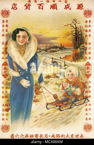 Woman pulls boy on sled. - Stock Image
