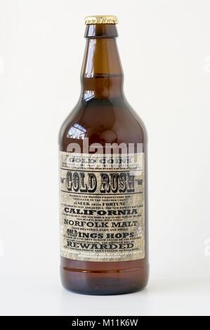 Brown bottle of beer GOLD RUSH brewed in Norfolk England UK - Stock Image