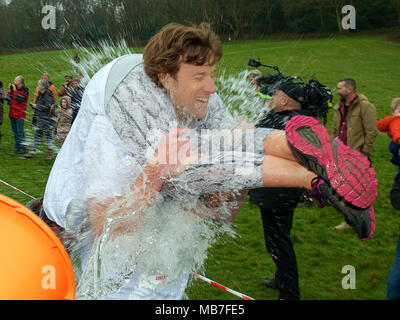 The 11th UK Wife Carrying Race takes place at The Nower, Dorking, Surrey, UK. 10.30am Sunday 8 April 2018. Photo by ©Lindsay Constable/Alamy Live News - Stock Image
