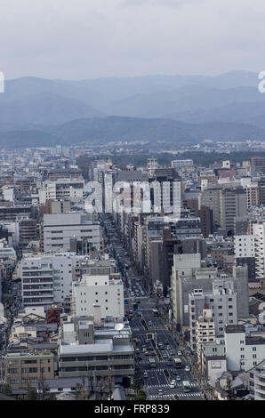 View from Kyoto Tower down Karasuma Street and the North of the City with traffic passing by on the streets below - Stock Image