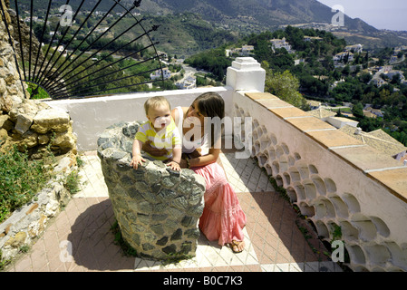 Mother and toddler visiting Mijas Pueblo, Costa del Sol, Andalucia, Spain - Stock Image