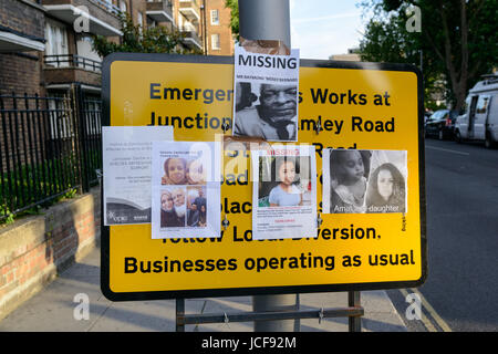 London, UK. 15th June, 2017. Search for missing people on a road sign near Grenfell Tower. The Grenfell Tower fire - Stock Image