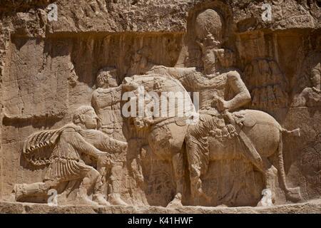 The triumph of Shapur I over the Roman emperors Valerian and Philip the Arabat Naqsh-e Rustam near Persepolis Shiraz, Fars Province, Iran - Stock Image