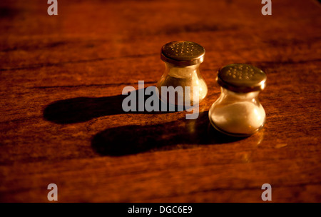 salt and pepper on wooden table - Stock Image