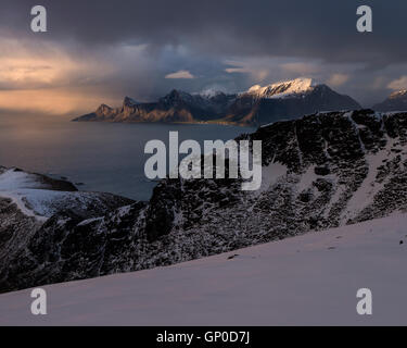 View from summit of Ryten towards distant mountains of Flakstadøy, Moskenesøy, Lofoten Islands, Norway - Stock Image