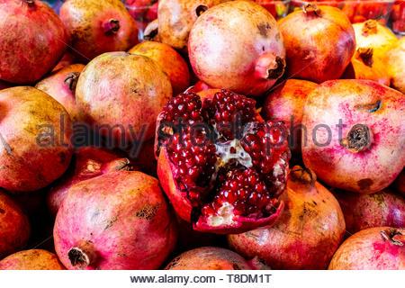 Rotterdam, Netherlands. Huge Stack of Pomegranates for sale on a Market-hall market stand. - Stock Image