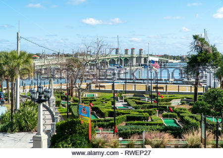 The Bridge of Lions and a miniature golf course in the historic district of Saint Augustine, Florida USA - Stock Image