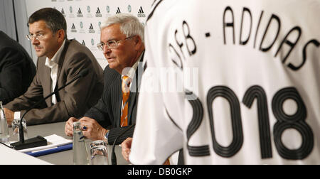 Herbert Hainer (L) CEO of adidas is pictured at a press conference with the president of the German Soccer Federation - Stock Image