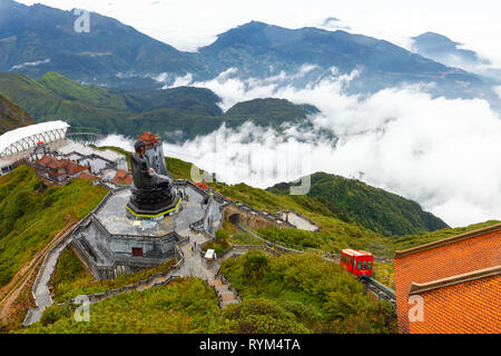 Sapa, Vietnam - October 08, 2018: A view to the Big Buddha statue and the funicular tram from the summit of the Fansipan Mountain on October 8, 2018,  - Stock Image