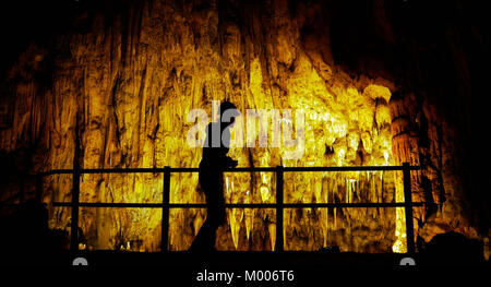 silhouette of a tourist visiting the Spilja Vranjaca show cave cavern in Bistricka ulica 19 Kotlenice Croatia - Stock Image
