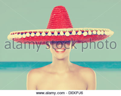 Young woman wearing red sombrero - Stock Image