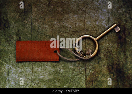Old key and tag - Stock Image