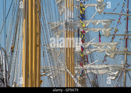 Details of masts, topsails, rigging and flags of the tall ships at Lisbon dock for the Tall Ships race 2016 - Stock Image