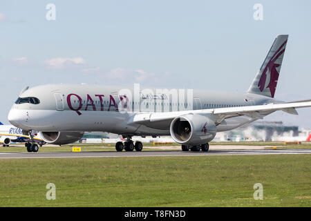 A Qatar Airways Airbus A350, registration A7-ALH, preparing for take off from Manchester Airport, England. - Stock Image