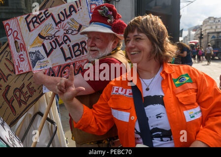 London, UK. 13th August 2018.  Brazilians protest outside the Brazilian embassy calling for the release of Luiz Inacio Lula da Silva, a former trade union leader who was President of Brazil from 2003-11 to enable him to stand for election again in October.  One of the orgnaises poses with Scottish supporter Harry McEachan. Credit: Peter Marshall/Alamy Live News - Stock Image