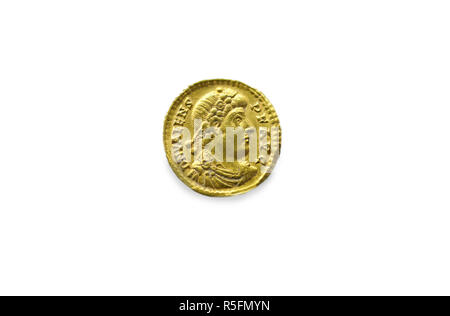 Gold coin depicting the Eastern Roman Emperor Valente. Isolated over white - Stock Image