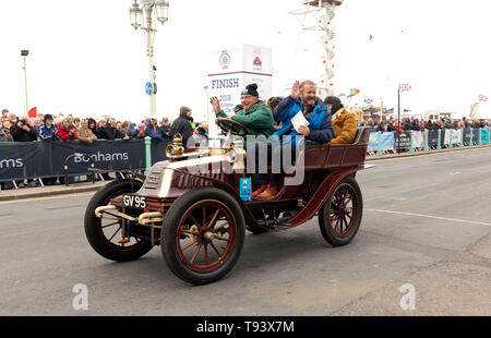 Mr Graham Beckett driving his 1902 Darracq,  across the finishing line of the 2018 London to Brighton Veteran Car Run - Stock Image