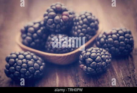 Fresh blackberries on wooden surface - Stock Image