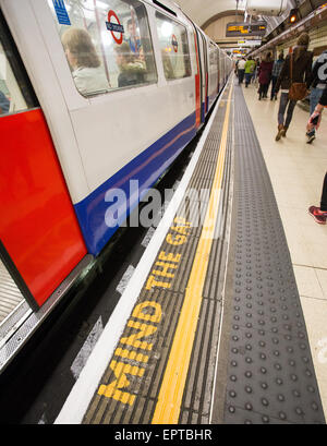 A Mind The Gap sign on the London Underground at a station in Britain - Stock Image