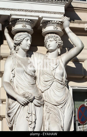 Two caryatids by Austrian sculptor Franz Anton von Zauner support the main entrance to the Palais Pallavicini at - Stock Image
