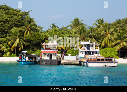 Maldives boat - working boasts in the small island harbour, Kuramathi island, Rasdhoo atoll, the Maldives Asia - Stock Image