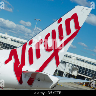 Tail fin of a Virgin Australia 320 aircraft at Sydney airport - Stock Image