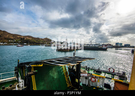 The Isle of Skye car ferry docks in Mallaig harbour on the Scottish mainland after its crossing from Armadale. - Stock Image