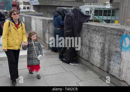 Press photographers work under dark conditions while activists with Extinction Rebellion campaign for a better future for planet Earth after blocking Waterloo Bridge and as part of a multi-location 5-day Easter protest around the capital, on 16th April 2019, in London, England. - Stock Image