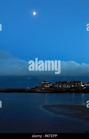 Cw 6596 Amble harbour side under the moon.  Amble is a small town on the north east coast of Northumberland This is the south harbour as dusk falls. - Stock Image