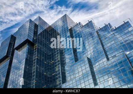 Reflective bullding with sky - Stock Image