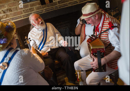 Thatxted Essex England UK. Morris dancers traditional singing in the Swan Pub after dancing in the Church Car park on Bank Holiday Monday. 6 May 2019 - Stock Image