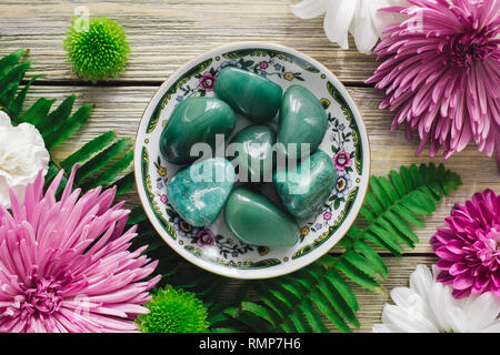 Decorative Plate with Green Aventurine, Chrysoprase and Spring Flowers - Stock Image