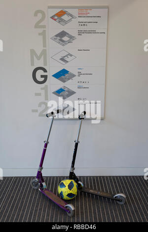 A football and two scooters lean against a floor plan of Kensington's Design Museum, on 6th January, in London, England. - Stock Image