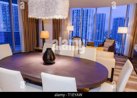 Miami Florida Epic Hotel luxury boutique lodging hospitality guest room suite dining room windows view modern decor - Stock Image